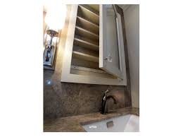 mounting a mirror corner vanity cabinet bathroom with corner