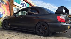 black subaru subaru satin black wrap concepts