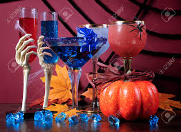 happy halloween ghoulish party cocktail drinks with spider web