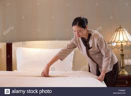 Bed Making People Making Bed In Modern Bedroom Stock Photo Royalty Free