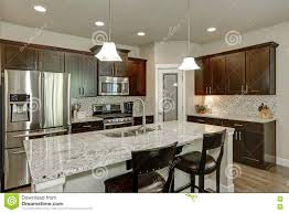 classic kitchen room interior with large kitchen island stock