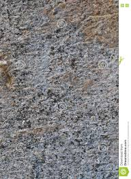 grey coarse concrete stone wall texture vertical closeup old aged