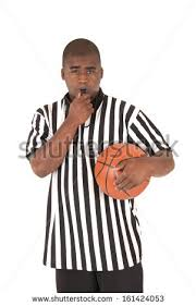 Whistle Meme - black referee blowing whistle holding basketball stock photo