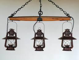 Wagon Wheel Lighting Fixtures Big Rock Lanterns Also Makes Stunning Single Tree And Wagon Wheel