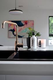 black kitchen sink and taps chrison bellina