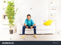 happy smiling black boy playing video stock photo 155396657