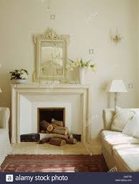 white painted mirror above fireplace in simple white living room