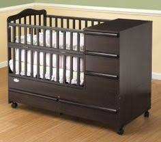 Mini Crib With Storage On Me Mission Style Toddler Bed With Storage Drawer In