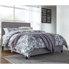 signature design by ashley dolante queen upholstered bed with