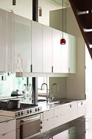 modern sleek kitchen design modern silver dishwasher between cabinet neat carot wooden floor