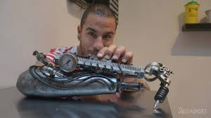 a disabled person with a prosthesis machine for the tattoo in a