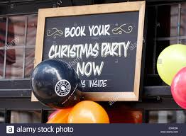sign outside a pub reading book your christmas party now