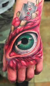 back of hand tattoos an horror tattoo full of color that evokes the type of emotion