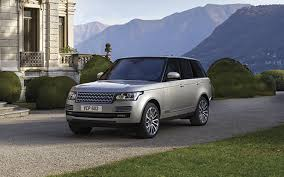 dark silver range rover on the trail of a range rover photographer in pursuit of the