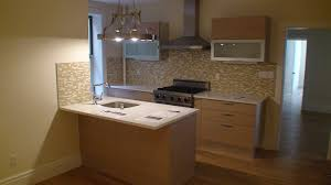 chic tile backsplash in light brown small apartment kitchen