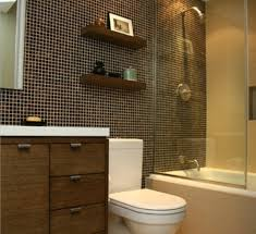 small black tiles with shining glass enclosure for tiny bathroom