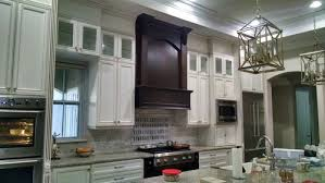 what do you put on top of kitchen cabinets what do you put in your glass top kitchen cabinets