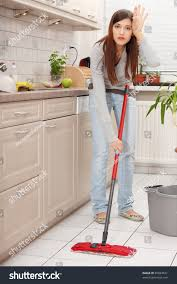 woman holding mop cleaning kitchen floor stock photo 85834531