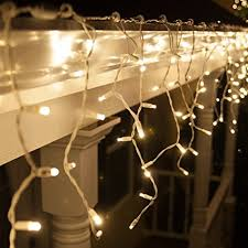 twinkling white led icicle lights amazon com 70 led icicle lights 7 5 white wire outdoor christmas