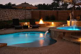 5 round rock swimming pool spa waterfall covered patio 4 reliant
