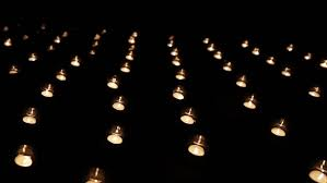 beautiful candle lights in pitch black stock footage