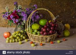 fruit flowers baskets still with fruit baskets are arranged with a beautiful vase