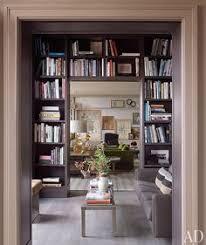 Green Bookshelves - a fashionable life hutton wilkinson emerald green rooms green