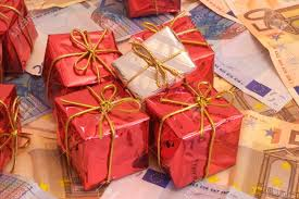christmas presents over a bunch of money euro bills that