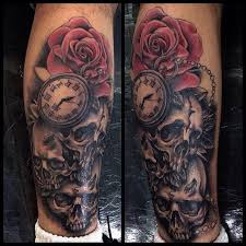 black ink skulls with pocket watch and rose tattoo on right leg