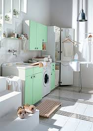 interior serene white laundry room design with cleaning kit