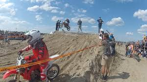 freestyle motocross ramps dirt bike rider flies off bike in mid air jukin media