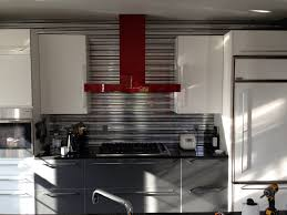 metallic kitchen inspiration using industrial cityscape tiles from