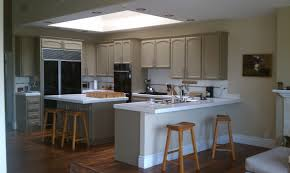 black woood kitchen island beige tile floor kitchen countertop