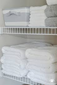 bathroom closet ideas organized bathroom linen closet anyone can kelley nan