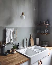 torchon de cuisine design grey walls with golden accents in the kitchen at home