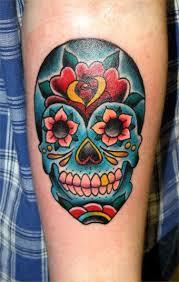 colorful sugar skull on forearm