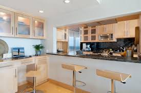 maple kitchen cabinets with white granite countertops modern kitchen with maple cabinetry and granite countertops