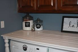 table over washer and dryer i really should be sleeping laundry room counter