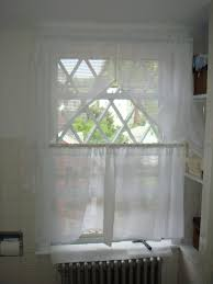 white transparent curtains with two layer for glass windows having