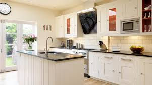 white shaker kitchen with red interiors from harvey jones