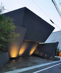 wraps angular wall around srk residence in tokyo
