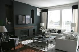 bedroom dark grey painted living room with fireplace and wooden