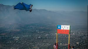 Cile Flag Watch Wingsuit Pilot Smashes Through Chilean Flag Youtube