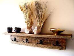 natural brown wooden floating shelf combined with double black