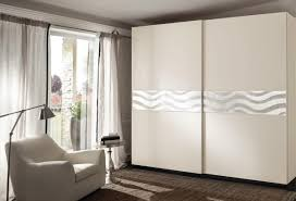 wall wardrobe with curvilinear motifs on 2 ports idfdesign