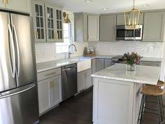 Gray Cabinets In Kitchen by Microwave Above Stove With Raised Cabinet Above Kitchens