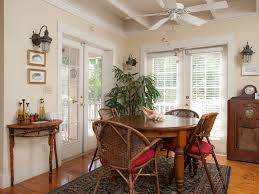 cottage dining room with french doors u0026 exposed beam in sanibel