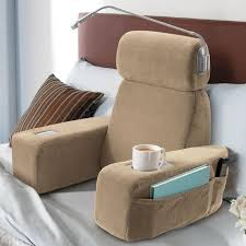 bed rest pillow with cup holder massaging bed rest pillow with light pockets a cup holder and