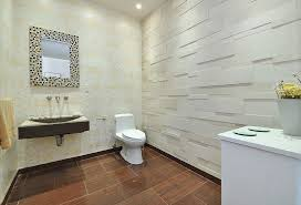 modern powder room with wall mounted sink by the corcoran group