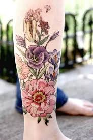 colorful floral tattoo on right leg